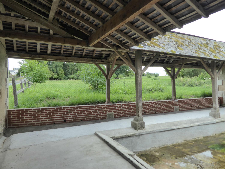 Restauration partielle du lavoir de Sarcé